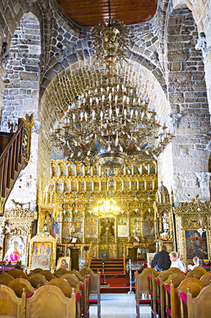 iconostasis: LARNAKA, CYPRUS - AUGUST 5, 2014: The interior of the St Lazarus church with the golden iconostasis and large chandelier, on August 5 in Larnaka.