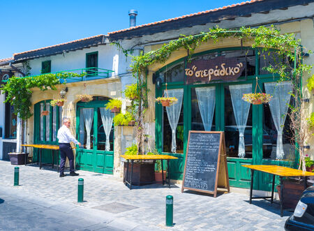 flower shop: LARNAKA, CYPRUS - AUGUST 5, 2014: The nice cafe located in the old warehouse decorated with many plants and flowers in pots, on August 5 in Larnaka.