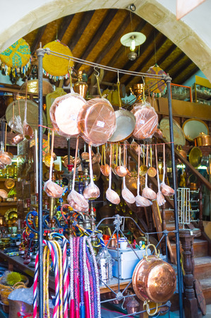 household goods: The tiny shop, selling household goods, metal utensils and souvenirs, located in the old neighborhood of Larnaca, Cyprus. Stock Photo