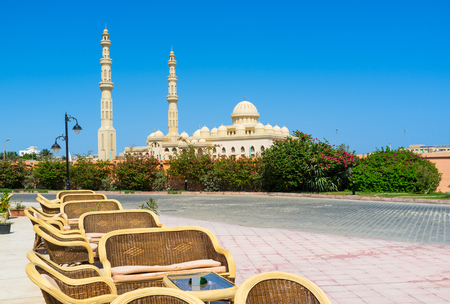 The cozy outdoor cafe in Hurghada marina with the view on the Central Mosque, Egypt.