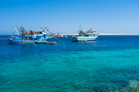 The fishing boats next to the port, Hurghada, Egypt. photo