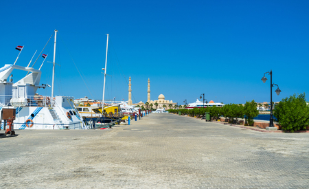 The walkway along the sea in Hurghada Marina with the view on the Central Mosque, Egypt.