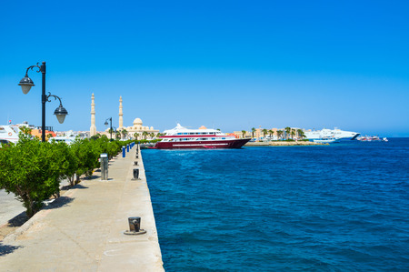 The cruise liner in Hurghada Marina with the Central Mosque on the background, Egypt.