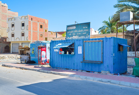 household goods: HURGHADA, EGYPT - OCTOBER 5, 2014: The small shop made from container with household goods in poor neighborhood of luxury resort, on October 5 in Hurghada. Editorial