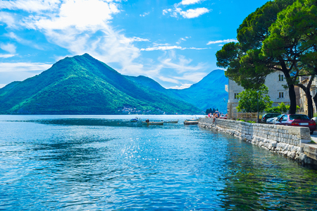 The nice views on the high mountains around the narrow bay, medieval architecture and bright blue sea makes Perast popular among tourists, Montenegro. photo