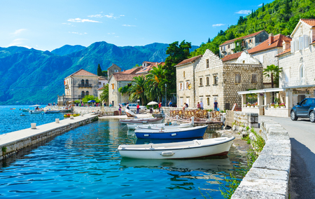 The tiny port in the city centre of Perast makes it even more idyllic and cozy, Montenegro. photo