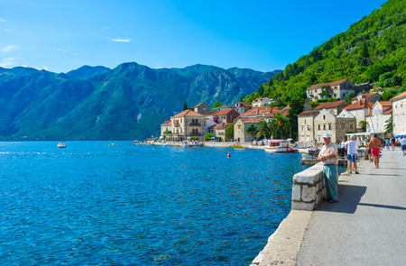 PERAST, MONTENEGRO - JULY 13, 2014: The promenade is the favorite tourist and fishermen place, there are many cafes and souvenir shops here, on July 13 in Perast.