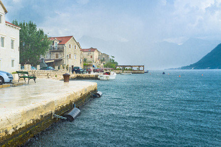 The best place to wait out the rain is the nice cafe or the tourist ship, Perast, Montenegro.