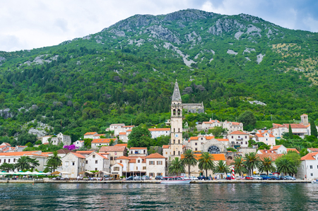 The scenic medieval town located at the foot of the mountain, Perast, Montenegro. photo