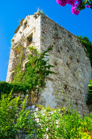 The ruins of the large mansion located on the hilly abandoned street in Perast, Montenegro. photo
