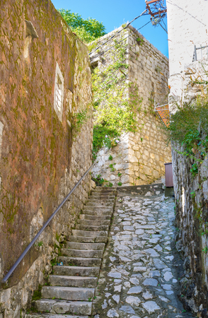 The medieval streets of Perast are made of white stone, Montenegro. photo