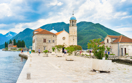 ted: The basilica of Our Lady of the Rocks loca ted on the same named islet and the islet of St George on the background, Perast, Montenegro.