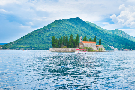 The small island in Kotor bay contains Saint George Benedictine monastery and the old graveyard, Perast, Montenegro. photo