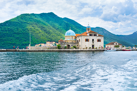The islet of Our Lady of the Rocks is the notable landmark, located in Kotor bay, Perast, Montenegro. photo