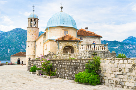 The scenic basilica with the small museum located on Our Lady of the Rocks islet, Perast, Montenegro. photo