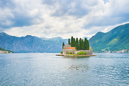 The Benedictine monastery on St George islet is closed for tourist visiting, but the boats sail around it, Perast, Montenegro.