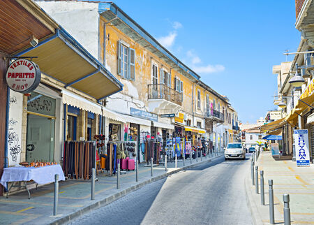 LIMASSOL, CYPRUS - AUGUST 4, 2014: The old town is full of tiny tourist shops, large markets with local souvenirs, food and drink, on August 4 in Limassol. Publikacyjne