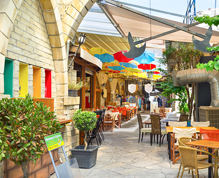 LIMASSOL, CYPRUS - AUGUST 4, 2014: The indoor passage between two streets is used as the area for the cafes and souvenir shops, on August 4, 2014.