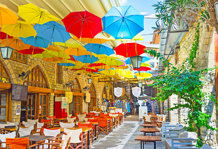 LIMASSOL, CYPRUS - AUGUST 4, 2014: Many colorful umbrellas decorate the sailing of the indoor passage in the old town, on August 4, 2014.