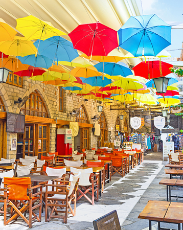 LIMASSOL, CYPRUS - JULY 6, 2014 The colorful umbrellas are the nice decoration for the sailing in cafe, on July 6 in Limassol.