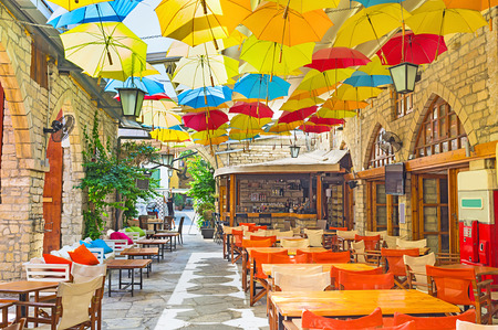 The weather doesnt matter, if you are under umbrella in the cozy cafe, Limassol, Cyprus.