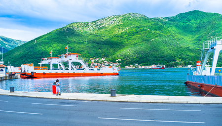 ferries: The bright ferries in Verige Strait with the green mountains on the background, Montenegro. Editorial
