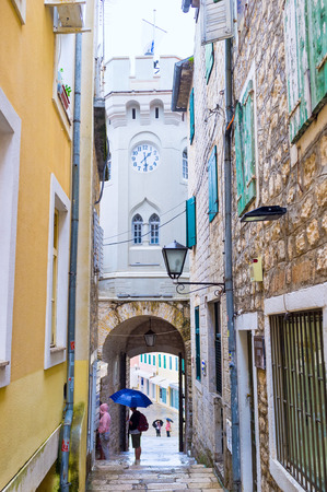 The gate with the clocktower is the medieval exit from the town, Herceg Novi, Montenegro. photo