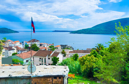 neighboring: The villas of Montenegrins in Herceg Novi located on the hills and overlooks the view on the Kotor bay and neighboring mountains.