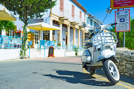 LEFKARA, CYPRUS - AUGUST 2, 2014: The white scooter parked next to the restaurant, on August 2 in Lefkara.