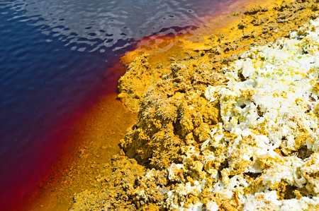 toxicology: The yellow bank of the mine lake with the sulfur crystals, Sia, Cyprus.