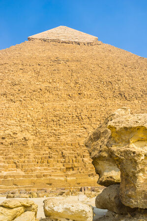 chephren: The Pyramid of Khufu surrounded by the large stones, broken away from its walls, Giza, Egypt.