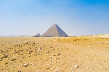 necropolis: The ancient Pyramids in Giza Necropolis surrounded by desert sands, Egypt.
