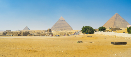 cheops: Three largest Pyramids and Great Sphinx in the middle on the foreground, Giza, Egypt.