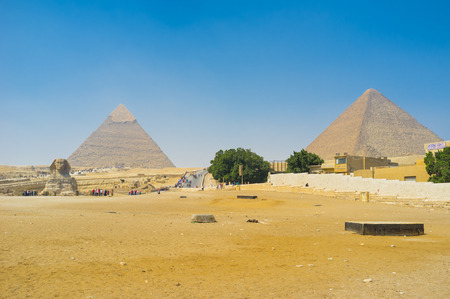 cheops: The Pyramids and Sphinx are probably the most famous monumental statues in the world, Giza, Egypt.