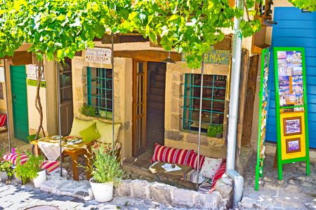 pleasent: STARI BAR, MONTENEGRO - JULY 14, 2014: The tiny cafe with the nice terrace for the pleasent dinner, on July 14 in Stari Bar.