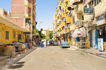 residential street: ASWAN, EGYPT - OCTOBER 6, 2014: The old residential street next to the central tourist market, on October 6 in Aswan.