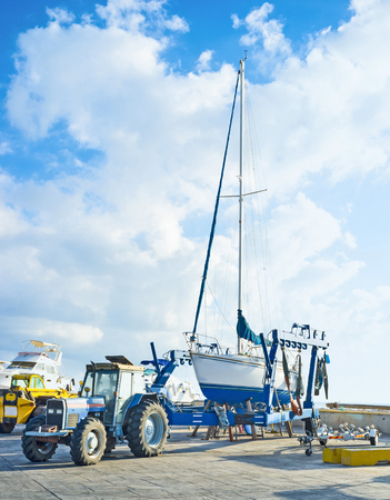 boat trailer: The yacht stands on the boat trailer in port of Latchi, Cyprus. Editorial