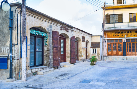 polis: POLIS, CYPRUS - AUGUST 3, 2014: The small cozy cafe located on the medieval street, on August 3 in Polis.