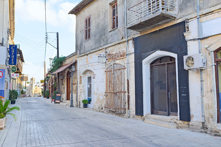 polis: POLIS, CYPRUS - AUGUST 3, 2014: The narrow street with cafes and bars leads to the old church, on August 3 in Polis.