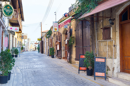 polis: POLIS, CYPRUS - AUGUST 3, 2014: The tiny streets of town are full of cozy cafes, souvenir shops and old villas, on August 3 in Polis. Editorial