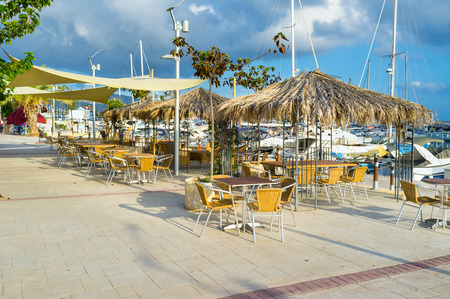 renowned: The outdoor restaurant in the traditional Cypriot village of Latchi, that is renowned across Cyprus for its fresh fish and excellent fish restaurants.
