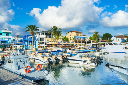 The harbor of Latchi village with the numerous cafes and bars at the central promenade, Cyprus.