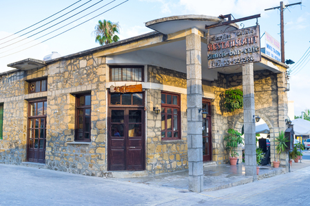 polis: POLIS, CYPRUS - AUGUST 3, 2014: The small family restaurant located on the central street and boasts local wines and cuisine, on August 3 in Polis.