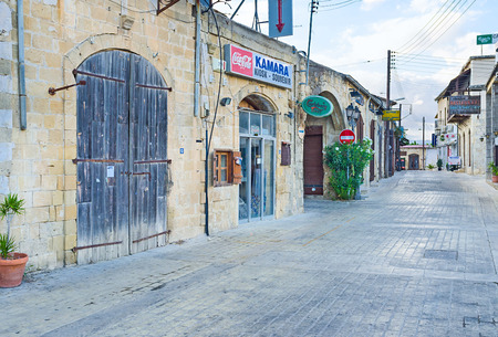 polis: POLIS, CYPRUS - AUGUST 3, 2014: Griva Digeni is the central street with many tourist shops and cafes, on August 3 in Polis.