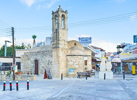 polis: POLIS, CYPRUS - AUGUST 3, 2014: The old church located on the central town square and surrounded by the large tourist area, on August 3 in Polis.