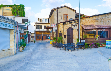 polis: POLIS, CYPRUS - AUGUST 3, 2014: The old tourist street with the numerous cafes and bars, located in the town centre, on August 3 in Polis.