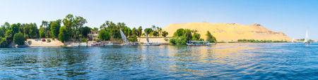 bank western: Panorama of the Kitcheners island with the desert western bank on the background, Aswan, Egypt.