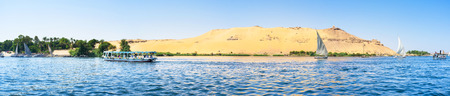 nile river: Panorama of the western bank of Nile river with the famous ancient landmark, Aswan, Egypt.