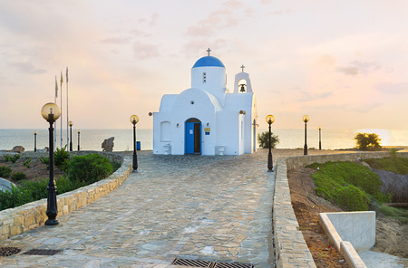 The coastal church of Agios Nikolaos located next to the Golden Coast harbor on the scenic promenade, Protaras, Cyprus.