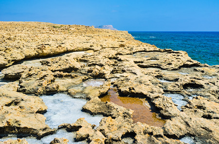 impregnable: The impregnable coast covered with the sharp rocks, the numerous puddles formed here at high tide, Ayia Napa, Cyprus. Stock Photo
